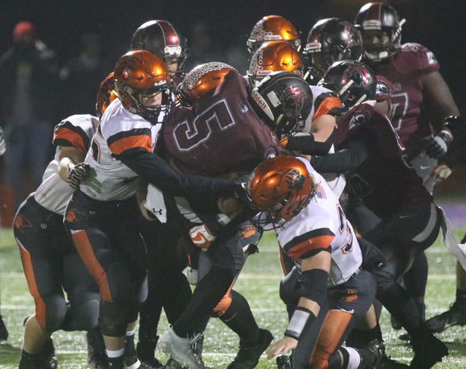 The Lucas Cubs gang tackle a Harvest Prep ball carrier during the Final 4 victory last week. The Cubs selfless attitude is why they are playing for a state title on Saturday.