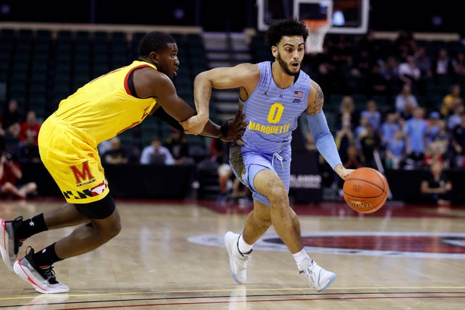 Marquette guard Markus Howard is fouled as he drives past Maryland guard Darryl Morsell. Howard had a rough day, hitting just 1 of 12 field goal attempts as he scored just six points against the Terrapins.