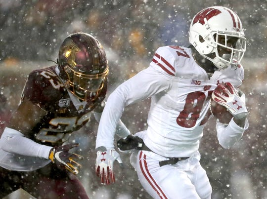 Wisconsin wide receiver Quintez Cephus catches a 47-yard touchdown,  outrunning Minnesota defensive back Jordan Howden.