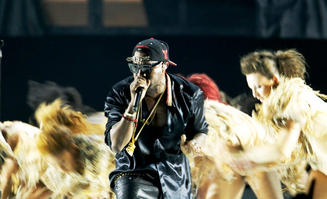 Kanye West and Kid Cudi perform at the Marcus Amphitheater Thursday June 30, 2011. jsainlar@JOURNALSENTINEL.COM