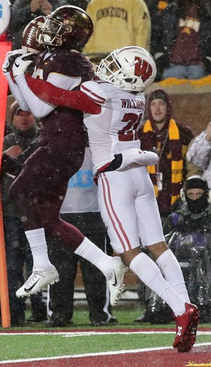 Wisconsin cornerback Caesar Williams breaks up a pass intended for Minnesota wide receiver Tyler Johnson during the fourth quarter.