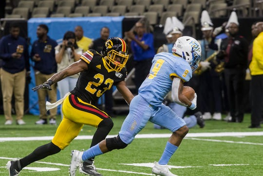 Grambling State's Kenan Fontenot (23) looks to make the tackle against Southern University's Cameron Mackey (9) during the 46th annual Bayou Classic at the Mercedes-Benz Superdome in New Orleans, La. on Nov. 30.