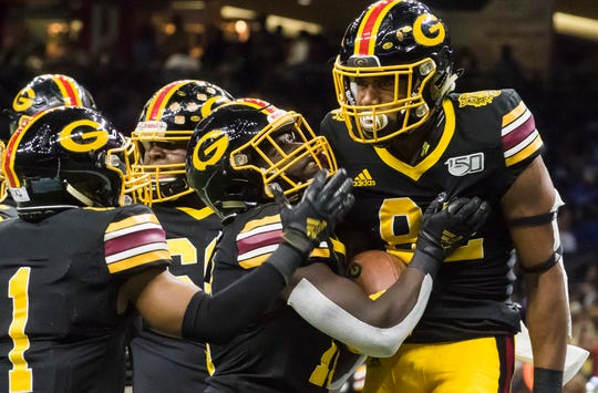 Grambling teammates congratulate De'Vante Davis (82) after scoring the opening touchdown of the 46th annual Bayou Classic against Southern University at the Mercedes-Benz Superdome in New Orleans, La. on Nov. 30.