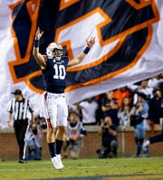 Auburn quarterback Bo Nix (10) celebrates after scoring a two point conversion against Alabama in second half action in the Iron Bowl at Jordan-Hare Stadium in Auburn, Ala., on Saturday, November 30, 2019.
