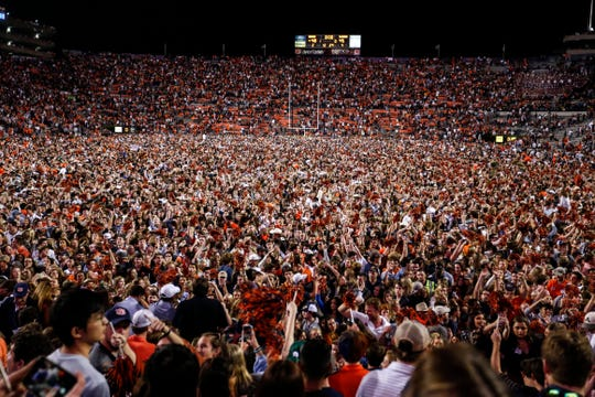 Auburn fans storm the field after they defeated Alabama 48-45 in the Iron Bowl on Saturday, Nov. 30, 2019, in Auburn, Ala.