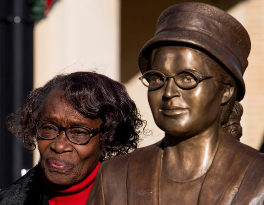 Mary Louise Smith, a plaintiff in the Browder vs. Gayle case that desegregated buses in Montgomery, stands beside the  Rosa Parks statue in downtown Montgomery, Ala., after is was unveiled on Sunday, December 1, 2019.