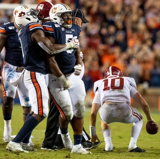Auburn defensive lineman Big Kat Bryant (1) and Auburn defensive lineman Derrick Brown (5) celebrate a stop of Alabama quarterback Mac Jones (10) in second half action in the Iron Bowl at Jordan-Hare Stadium in Auburn, Ala., on Saturday, November 30, 2019.