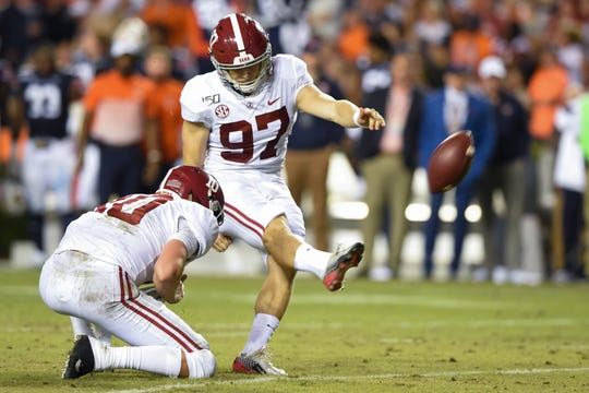 Nov 30, 2019; Auburn, AL, USA; Alabama Crimson Tide place kicker Joseph Bulovas (97) kicks during the third quarter against the Auburn Tigers at Jordan-Hare Stadium. Mandatory Credit: John David Mercer-USA TODAY Sports