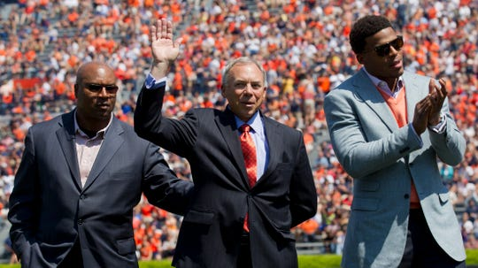 Auburn Heisman Trophy winners Bo Jackson (left), Pat Sullivan (center) and Cam Newton (right) are introduced prior to the annual spring A-Day game at Jordan-Hare Stadium in Auburn, Ala., Saturday, April 14, 2012.