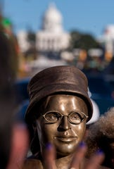 The new Rosa Parks statue stands on Dexter Avenue in downtown Montgomery, Ala., with the state capitol behind it, after its unveiling on Sunday, December 1, 2019.