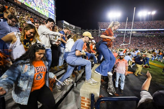 Auburn fans jump onto the field after they defeated Alabama 48-45 in the Iron Bowl Saturday, Nov. 30, 2019, in Auburn,