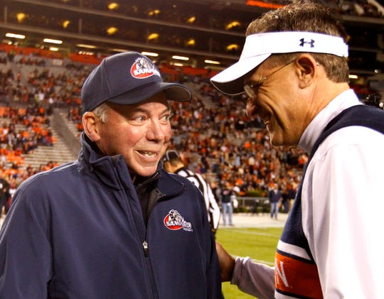 Samford head coach Pat Sullivan meets with Auburn head coach Gus Malzahn before an NCAA college football game on Saturday, Nov. 22, 2014, in Auburn, Ala.