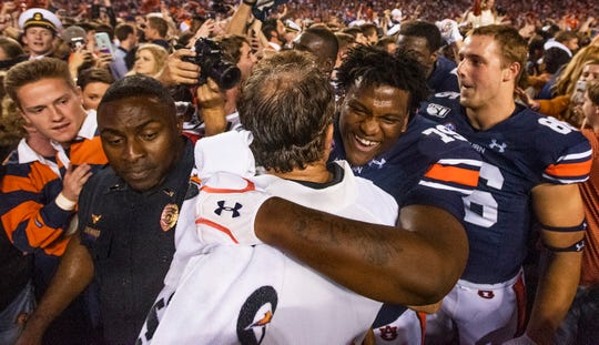 Auburn head coach Gus Malzahn hugs Auburn offensive lineman Kamaar Bell (79) in the Iron Bowl at Jordan-Hare Stadium in Auburn, Ala., on Saturday, November 30, 2019.