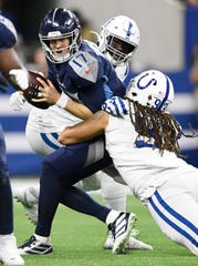 Tennessee Titans quarterback Ryan Tannehill (17) is sacked in the second quarter against the Indianapolis Colts at Lucas Oil Stadium Sunday, Dec. 1, 2019 in Indianapolis, Ind.