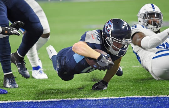 Tennessee Titans wide receiver Adam Humphries (10) dives in for the touchdown against the Indianapolis Colts in the first quarter at Lucas Oil Stadium Sunday, Dec. 1, 2019 in Indianapolis, Ind.