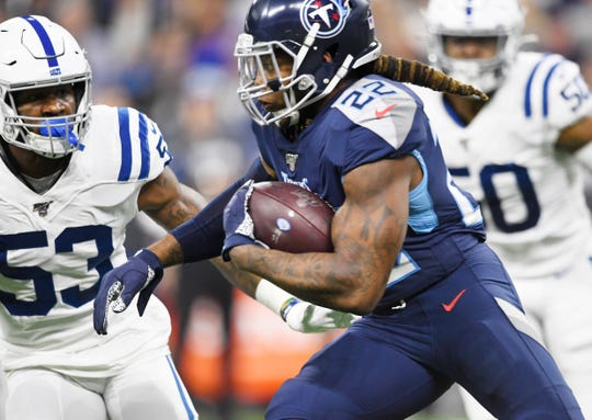 Tennessee Titans running back Derrick Henry (22) carries the ball during the first quarter against the Indianapolis Colts at Lucas Oil Stadium Sunday, Dec. 1, 2019 in Indianapolis, Ind.