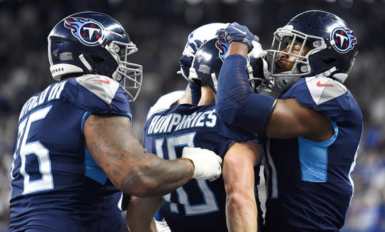Tennessee Titans wide receiver Adam Humphries (10) is congratulated after scoring a touchdown during the first quarter against the Indianapolis Colts at Lucas Oil Stadium Sunday, Dec. 1, 2019 in Indianapolis, Ind.