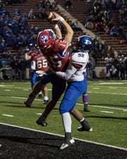 Licking Valley's Mitchell Ford catches the game-winning two-point conversion pass in a 25-24 victory against Poland Seminary in a Division IV state semifinal last November. The continued spread of the coronavirus has put the schedule beginning of the fall sports season in doubt.