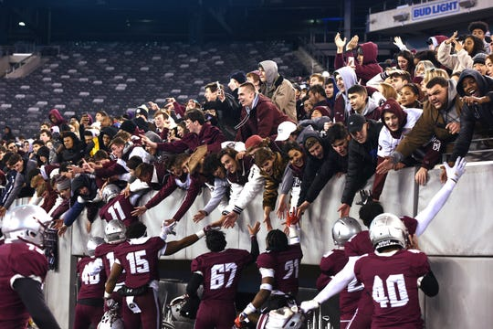 St. Peter's Prep players and fans celebrate after the Marauders won the Non-Public Group 4 championship.