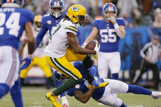 Davante Adams scores a touchdown against Giants. Of Adams' numbers, the Packers care most about TDs, but he says he's more interested in wins than stats.