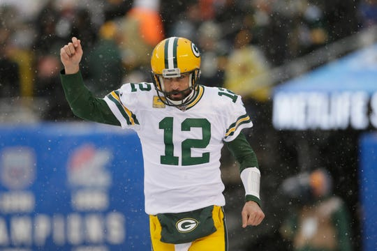 Green Bay Packers quarterback Aaron Rodgers reacts after a touchdown during the first half of an NFL football game against the New York Giants, Sunday, Dec. 1, 2019, in East Rutherford, N.J. (AP Photo/Adam Hunger)