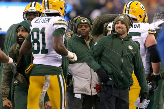 Packers coach Matt LaFleur, right, greets receiver Geronimo Allison on the sideline during Sunday's game against the Giants.