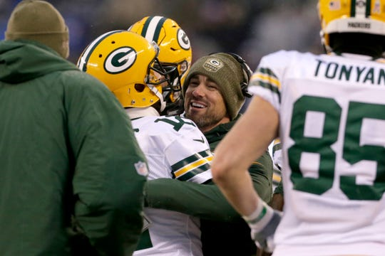 Green Bay Packers head coach Matt LaFleur hugs Aaron Rodgers during the second half of an NFL football game against the New York Giants, Sunday, Dec. 1, 2019, in East Rutherford, N.J. (AP Photo/Adam Hunger)