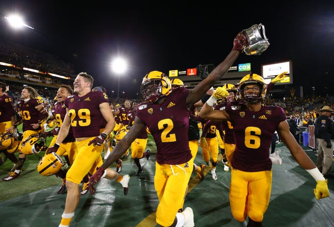 Arizona State Sun Devils wide receiver Brandon Aiyuk (2) holds-up the Territorial Cup trophy after defeating Arizona 24-14 at the 93rd Duel in the Desert on Nov. 30, 2019 in Tempe, Ariz.