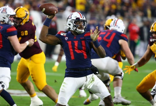 Arizona Wildcats quarterback Khalil Tate (14) throws the ball against ASU in the first half of the 93rd Duel in the Desert on Nov. 30, 2019 in Tempe, Ariz.