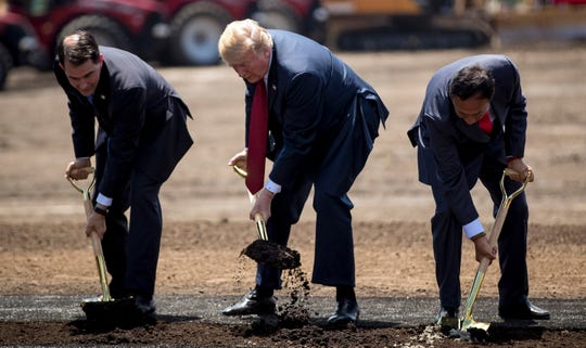 From left, Wisconsin Gov. Scott Walker, President Donald Trump and Foxconn chairman Terry Gou at a groundbreaking for the Foxconn plant Thursday, June 28, 2018 in Mt. Pleasant, Wis. (Brian Cassella/Chicago Tribune/TNS)