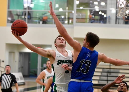 Jared Wagner of York College shoots for two and draws the foul from F&M's Matt Redhead, Sunday, Dec. 1, 2019.