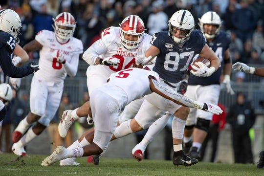 Penn State tight end Pat Freiermuth (87) looks to elude Indiana defensive back Juwan Burgess (5) in the second half of an NCAA college football game in State College, Pa., on Saturday, Nov.16, 2019. Penn State defeated 34-27. (AP Photo/Barry Reeger)