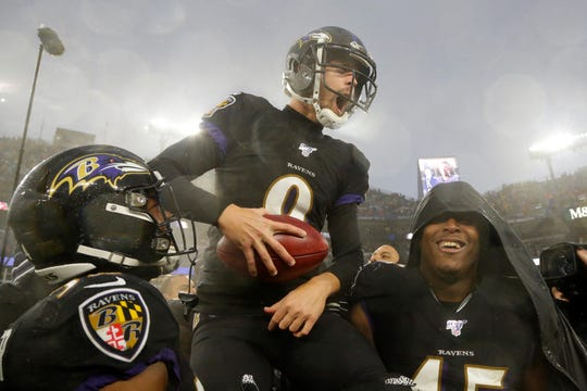 Baltimore Ravens kicker Justin Tucker (9) is carried off field by his teammates after making a game winning field goal against the San Francisco 49ers in an NFL football game, Sunday, Dec. 1, 2019, in Baltimore, Md. Ravens won 20-17. (AP Photo/Julio Cortez)