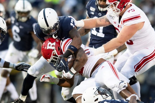 Penn State safety Garrett Taylor (17) tackles Rutgers running back Kay'Ron Adams (22) during an NCAA college football game in State College, Pa., on Saturday, Nov. 30, 2019. (AP Photo/Barry Reeger)