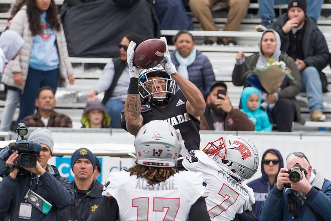 Nevada receiver Elijah Cooks, top, goes up for a pass over UNLV's Jericho Flowers (7) during last season's Fremont Cannon game in Reno.