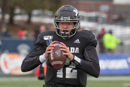 Nevada quarterback Carson Strong (12) looks to throw against UNLV second half of an NCAA college football game in Reno, Nev., Saturday, Nov. 30, 2019. (AP Photo/Tom R. Smedes)