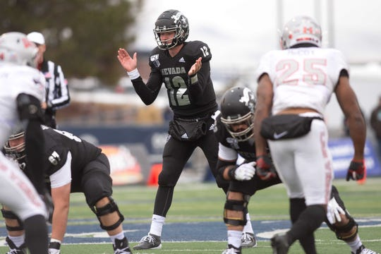 Nevada quarterback Carson Strong (12) begins a play against UNLV on Saturday.