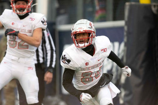 UNLV receiver Steve Jenkins (84) reacts after scoring the game-winning touchdown against Nevada on Saturday.