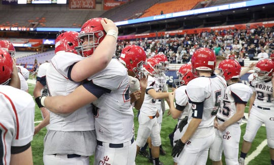 Lucas Scott and Tyler Hayes embrace after Chenango Forks won the Class B state title.
