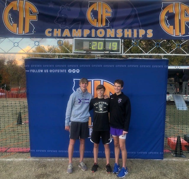 Senior Dylan Bland (center) with his Shasta High teammates, sophomore Dylan Jackson (left) and junior Thomas McClane (right), pose at the CIF cross country state championship in Woodward Park in Fresno.