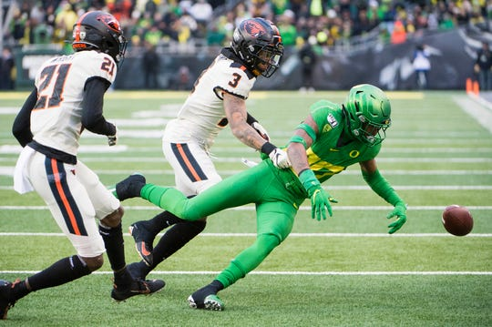 Nov 30, 2019; Eugene, OR, USA; Oregon State Beavers defensive back Jaydon Grant (3) strips Oregon Ducks wide receiver Bryan Addison (80) from the ball during the second half at Autzen Stadium. The Oregon Ducks beat the Oregon State Beavers 24-10. Mandatory Credit: Troy Wayrynen-USA TODAY Sports