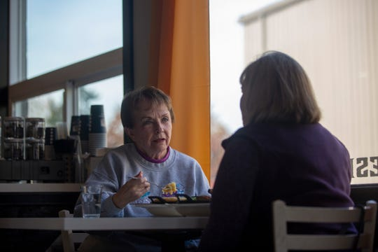 Patrons eat at the Cast Iron Cafe on Nov. 14 in Mount Angel, Ore.