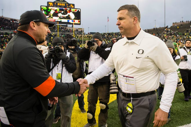 Oregon Ducks coach Mario Cristobal (right) and Oregon State counterpart Jonathan Smith will meet again when the Ducks face the Beavers on Nov. 27 at Reser Stadium in Corvallis.