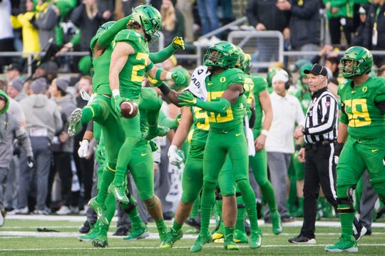 Nov 30, 2019; Eugene, OR, USA; Oregon Ducks safety Brady Breeze (25) celebrates with teammates after recovering a fumble during the second half agains the Oregon State Beavers at Autzen Stadium. The Oregon Ducks beat the Oregon State Beavers 24-10. Mandatory Credit: Troy Wayrynen-USA TODAY Sports