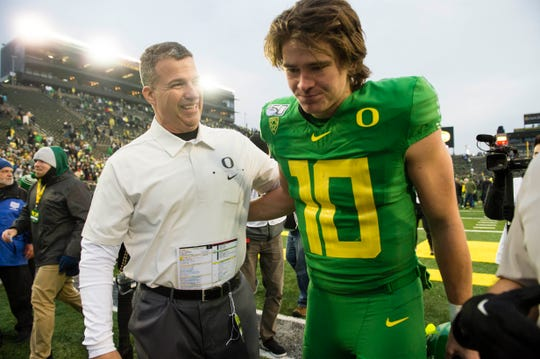 Nov 30, 2019; Eugene, OR, USA; Oregon Ducks head coach Mario Cristobal congratulates quarterback Justin Herbert (10) after a game against the Oregon State Beavers at Autzen Stadium. The Oregon Ducks beat the Oregon State Beavers 24-10. Mandatory Credit: Troy Wayrynen-USA TODAY Sports