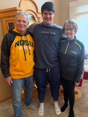 Lincoln senior Tyler Hiatt poses for a photo with his grandparents after committing to NDSU.