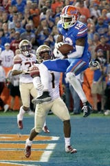 Florida wide receiver Van Jefferson (12) catches a 13-yard touchdown pass in front of Florida State defensive back Levonta Taylor (1) during the first half of an NCAA college football game Saturday, Nov. 30, 2019, in Gainesville, Fla. (AP Photo/John Raoux)