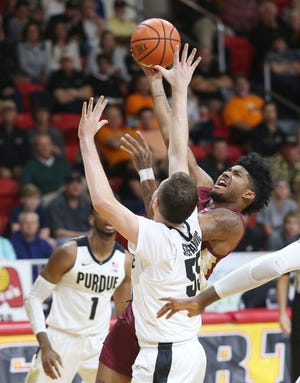 FSU's Trent Forrest puts up a shut against Purdue's Sasha Stefanovic during the championship game at the Emerald Coast Classic in Niceville, Fla., Saturday, November 30, 2019. [MICHAEL SNYDER/DAILY NEWS]