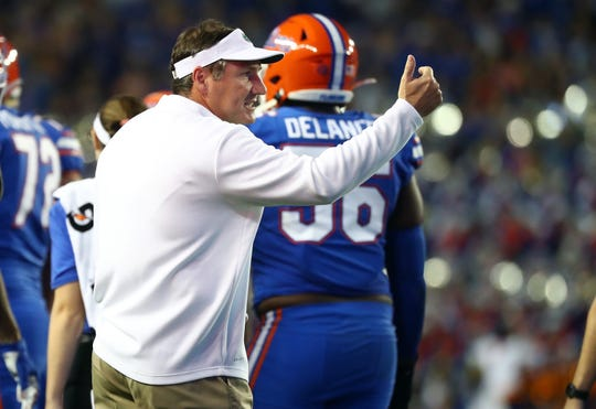 Nov 30, 2019; Gainesville, FL, USA; Florida Gators head coach Dan Mullen reacts against the Florida State Seminoles during the first quarter at Ben Hill Griffin Stadium. Mandatory Credit: Kim Klement-USA TODAY Sports