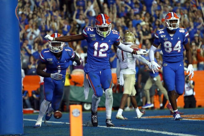 Nov 30, 2019; Gainesville, FL, USA; Florida Gators wide receiver Van Jefferson (12) celebrates as he scores a touchdown against the Florida State Seminoles during the second quarter at Ben Hill Griffin Stadium. Mandatory Credit: Kim Klement-USA TODAY Sports